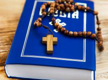 Holy Bible with wooden crucifix and rosary